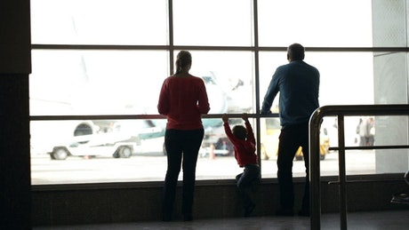 Young family waiting for their flight