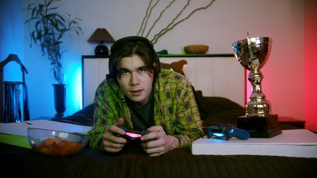 Young gamer man chatting while playing