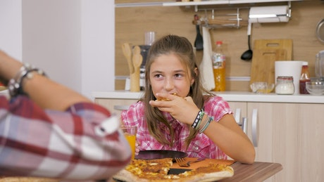 Young girl eating a pizza