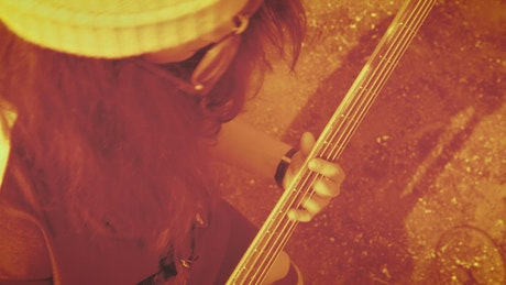 Young girl playing the bass, close up