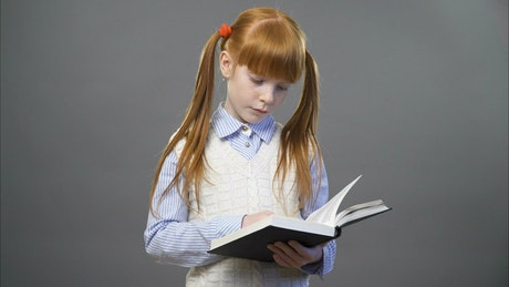 Young girl with an open book