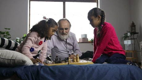 Young girls playing Chess