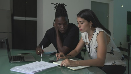 Young man and woman working together on an unsuccessful account