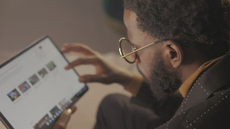 Young man browsing the Internet with a tablet