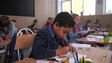 Young man drawing at his desk