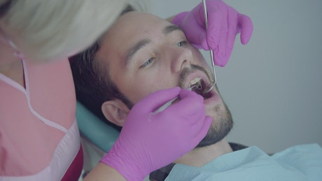 Young man in consultation with the dentist