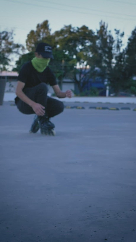 Young man skating in a parking lot