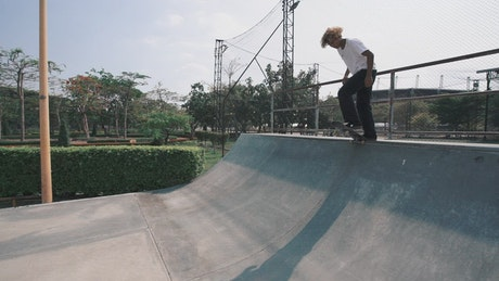 Young man skillfully skating in a park