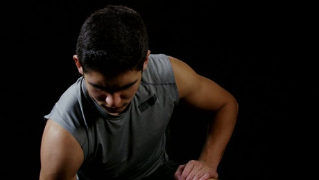 Young man using weights