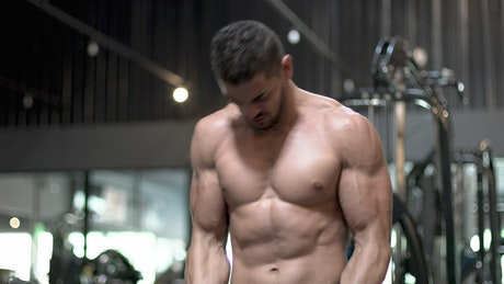 Young man working out hard with a dumbbell