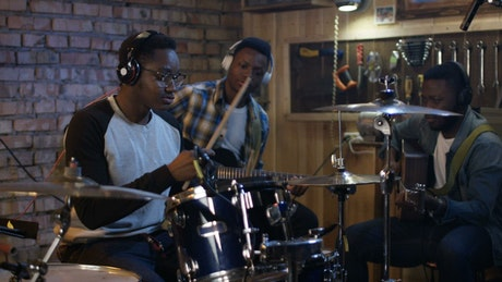 Young musicians rehearsing in the garage