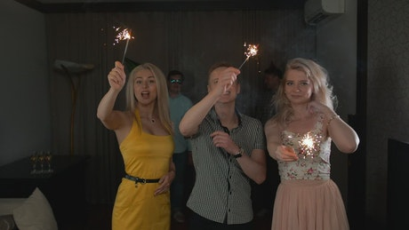 Young people partying with sparklers