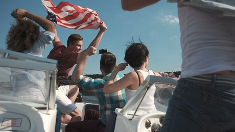 Young people with American flag on a boat