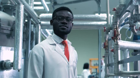 Young scientist looking at camera