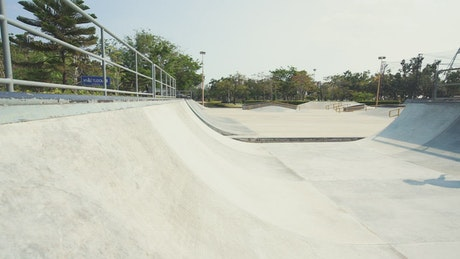 Young skateboarder practicing on the ramp