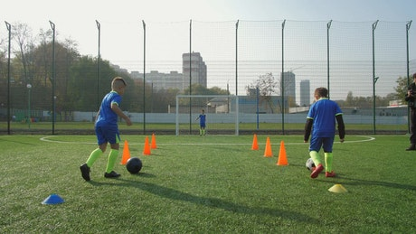 Young Soccer players training