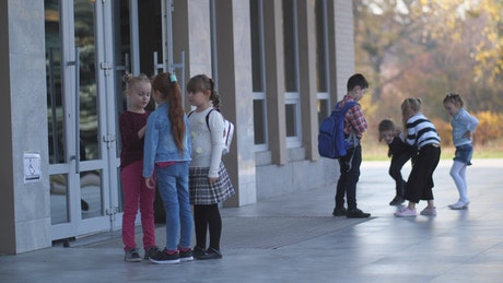 Young students waiting outside