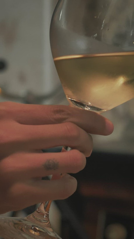 Young woman drinking champagne from a glass
