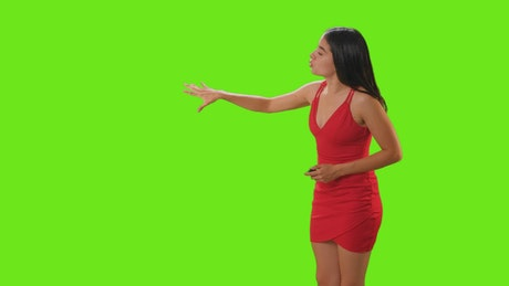 Young woman giving a presentation on a green screen