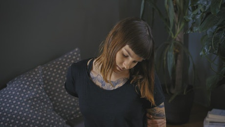 Young woman head-on doing neck stretches
