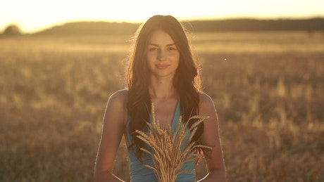Young woman holding wheat