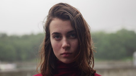 Young woman looking unhappy