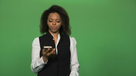 Young woman on a business call on a green screen