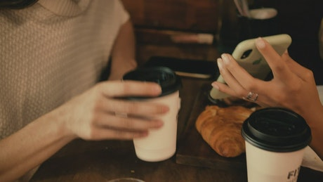 Young woman on a date with a friend in a coffee shop