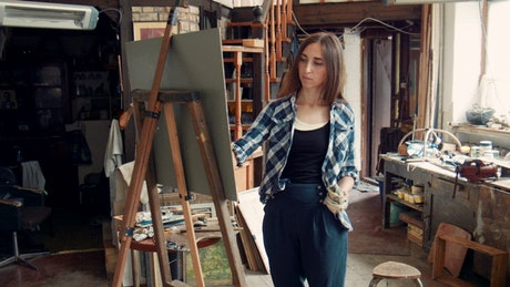 Young woman painting in the studio