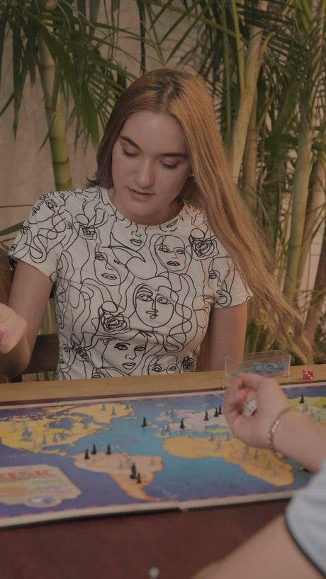 Young woman playing Risk