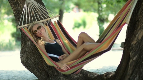 Young woman resting in a hammock in nature