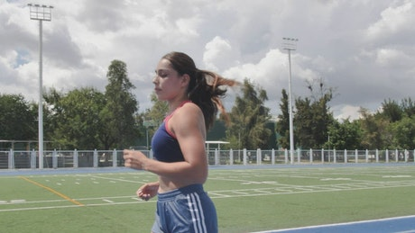 Young woman running in a sports center