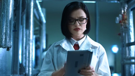 Young woman scientist with tablet smiling