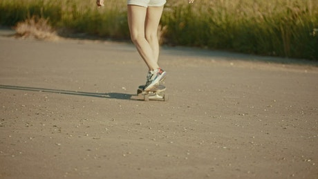 Young woman skating in the street