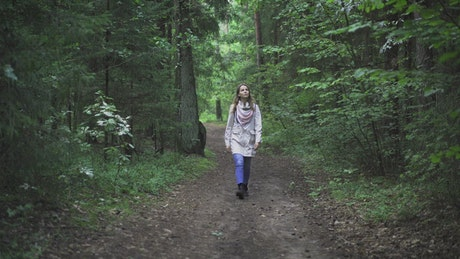 Young woman wandering in the forest