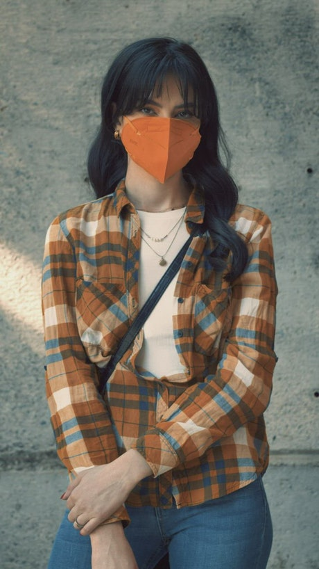 Young woman with a face mask, portrait