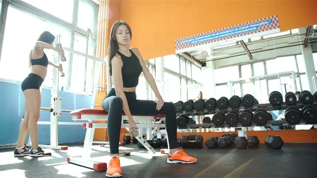 Young women taking care of their body in the gym