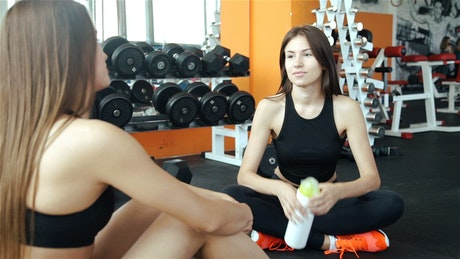 Young women talking on break at gym