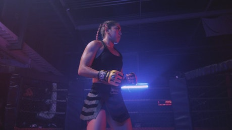 Young wrestler woman warming up on a ring