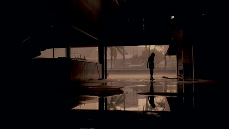 Zombie silhouette inside a dark building